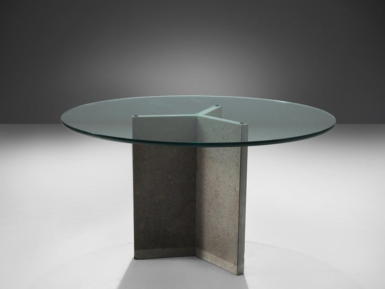 Dining table, stone, glass, Italy, circa1970.   This strong and sturdy stone and glass centre table is exemplary for the postmodern design of the post-war Italian era. This stone pedestal table has a playful yet hefty stone tripod foot. This