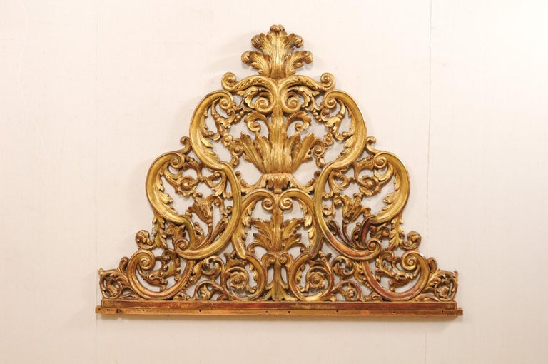 An Italian carved wood architectural fragment, which would make a great headboard for a bed, from the mid-20th century. This vintage wall decoration from Italy features beautifully pierced-wood carved body in a scroll and acanthus leaf motif. This