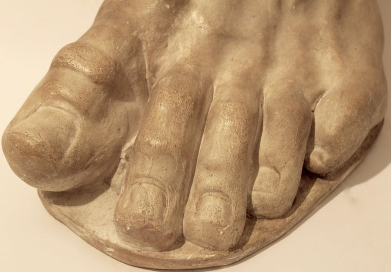 Italian plaster sculpture depicting the foot of the emperor Constantine, circa 1950. The cast represents a fragment of Colossus of the Constantine, a large statue of the late Roman emperor Constantine the Great dated circa 312-15. Widely considered