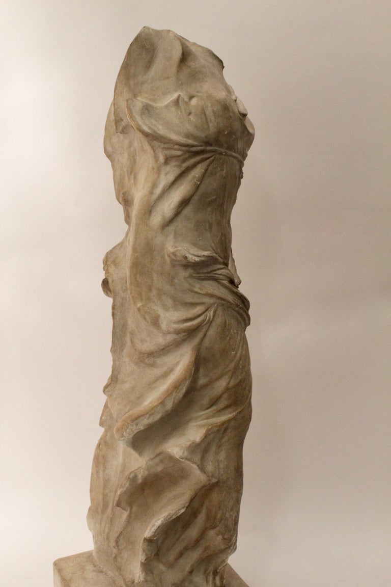 Italian studio plaster sculpture of NIKE of Samothrace, circa 1950. The winged victory of Samothrace, also called NIKE of Samothrace is a Hellenistic sculpture of the Greek goddess of victory, currently displayed in the Louvre. This plaster replica