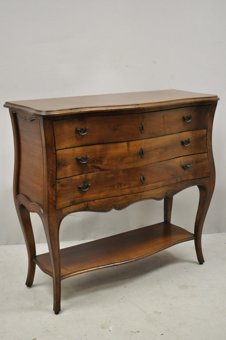 Italian Provincial French Louis XV style Cherrywood commode chest by B. Altman  Details: Lower shelf, solid wood construction, beautiful wood grain, original label, 3 dovetailed drawers, shapely cabriole legs, quality Italian craftsmanship, great