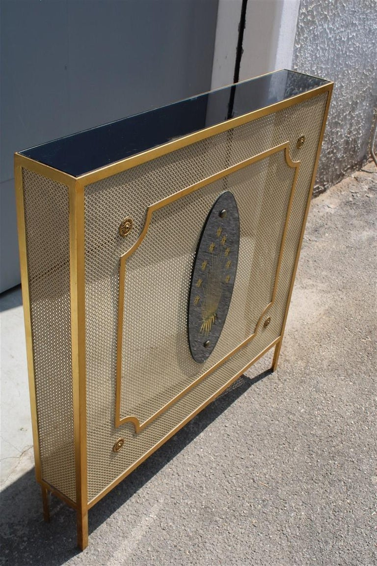 Italian radiator cover midcentury in perforated iron parts in pure gold 1950s. Upper surface in mirror, truly original pieces of great elegance.
