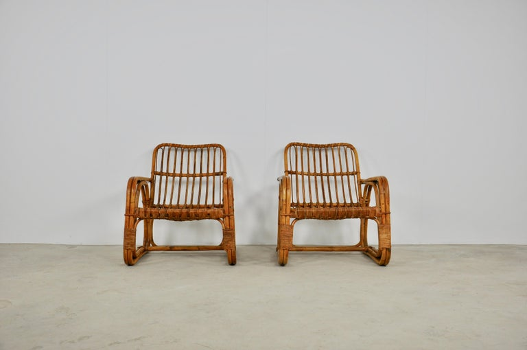 Pair of rattan armchairs. Slight wear and tear due to the age of the armchairs. Size: Seat height 37cm.