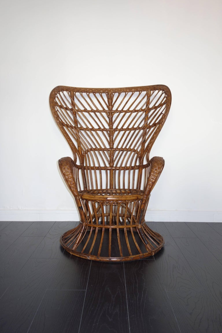 Rattan armchair by Gio Ponti and Lio Carminati for Bonacina. Italian handmade manufacture of the 1950s. Model created for the ship Conte Biancamaro. In its original state. In very good condition: beautiful patina, varnished original well preserved,