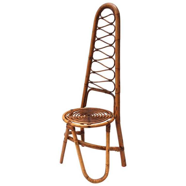 Italian rattan chair in the style of Gabriella Crespi, 1960s. Offered by Jed