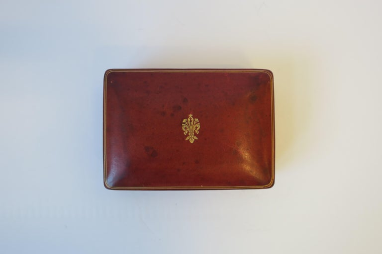 A beautiful midcentury Italian red burgundy 'ox blood' leather jewelry, vanity or trinket box with gold embossing. Marked 'LEATHER SCHOOL FLORENCE