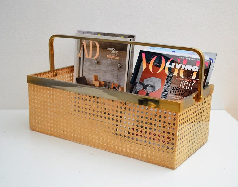 Beautiful and elegant, big magazine rack or holder. Solid brass frame with 24-karat gold plating and crystal clear Lucite with rattan cane inlet. Strong, excellent quality and large capacity for magazines or other. Reminds to works from Gabriella