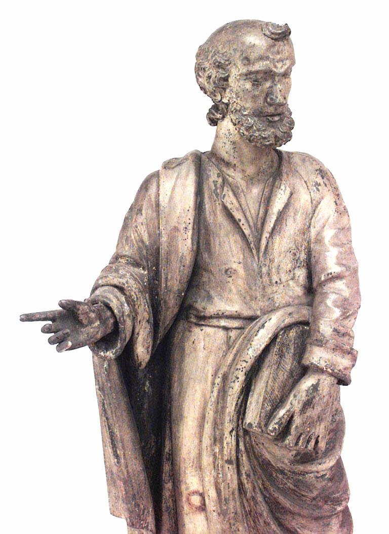 Italian Renaissance painted pine lifesize figure of religious scholar holding book,17th or 18th century.