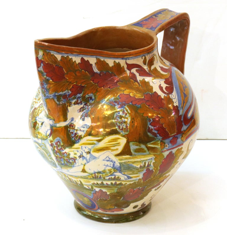 Italian Renaissance Revival large painted ceramic lusterware vessel in pitcher form. The piece has a painted front with a Renaissance inspired scene and a refined metallic iridescent glaze. Made in Italy during the 19th century, the piece is marked