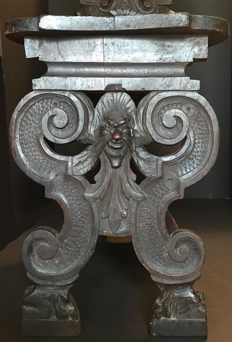 A fine Italian 19th century heavily carved Sgabello side chair. The entire front surface is hand carved and is beautifully sculpted. In the entrance halls of Italian Palazzos they were always an eyecatcher. They demonstrated the wealth and
