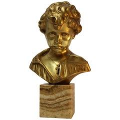 Bronze Bust of a Boy on a marble base, signed Donatello, Circa 1930
