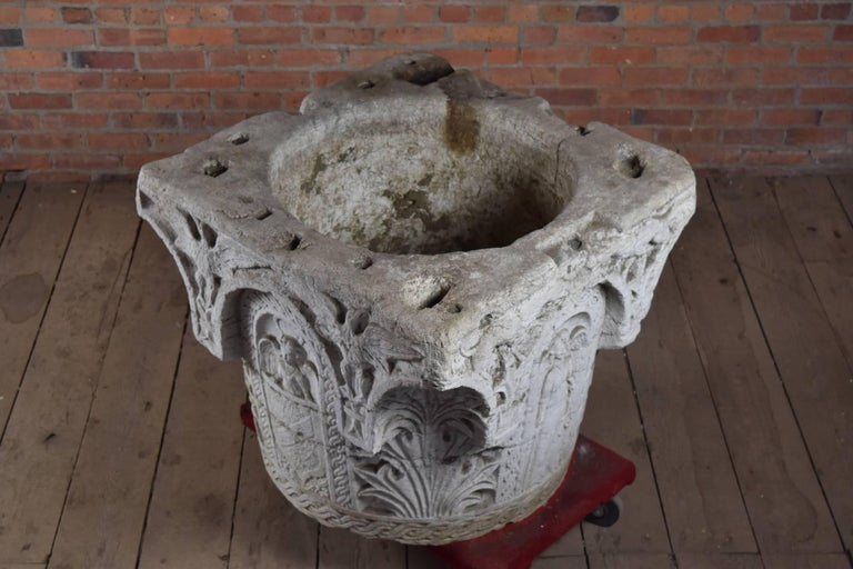 Italian Istrian stone well head from the Veneto area, elaborately carved and beautifully weathered. Renaissance style, late 19th century. The two featured family crests have not been identified so far. The very decorative object can be used in the