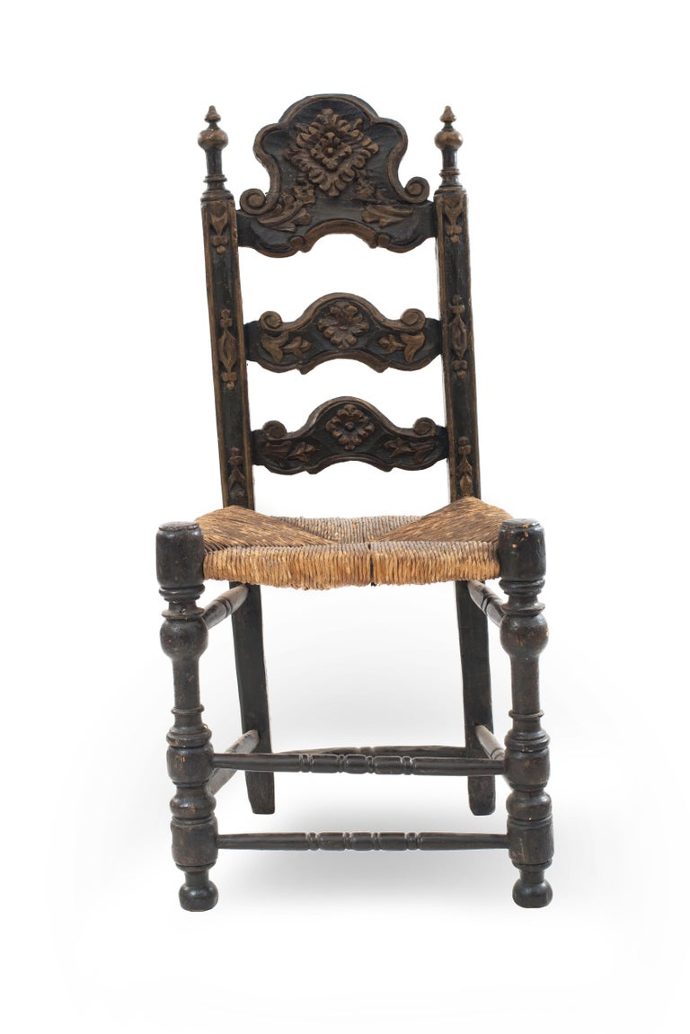 Italian Renaissance style (17th century) green and gold painted and carved ladder back high side chairs with rush seat.