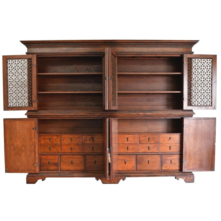 A magnificent Italian Renaissance-style bookcase cabinet that was faithfully copied from an original 17th century Italian Renaissance Tuscan archival with a stepped moulded cornice above a dentilled frieze. The upper bookcase has inset hand forged