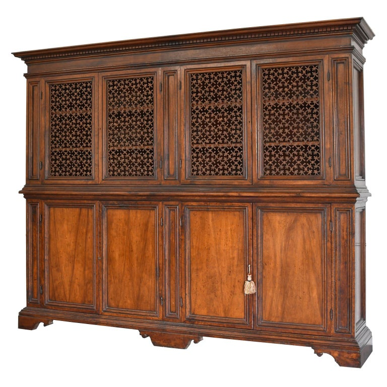 Carved Italian Renaissance Style Walnut Bookcase Cabinet with Iron Quatrefoil Panels For Sale