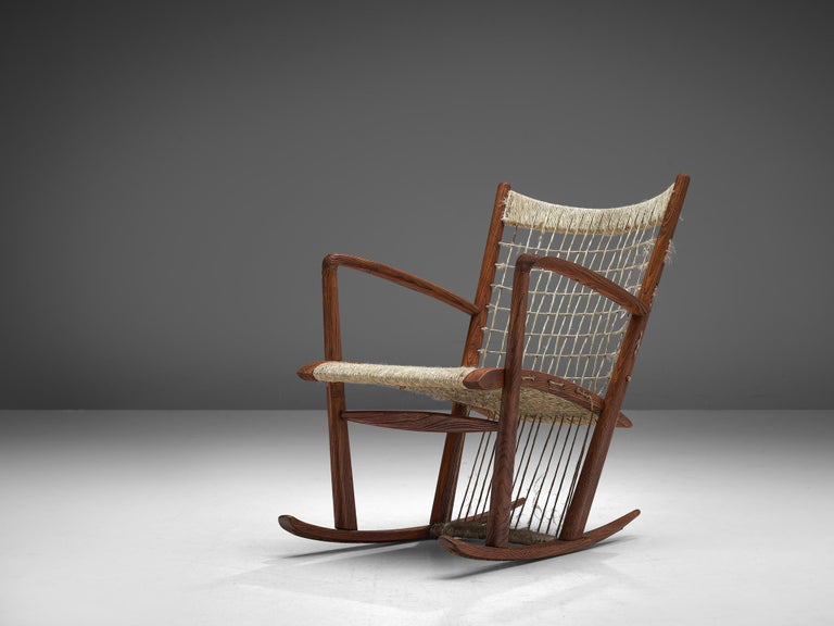 Guglielmo Pecorini, rocking chair, oak and rope, Italy, 1960s  Italian rocking chair with a classic country-like appearance, designed by the Italian Guglielmo Pecorini. The chair consists of an oak frame to whichthe rope is stretched in between.