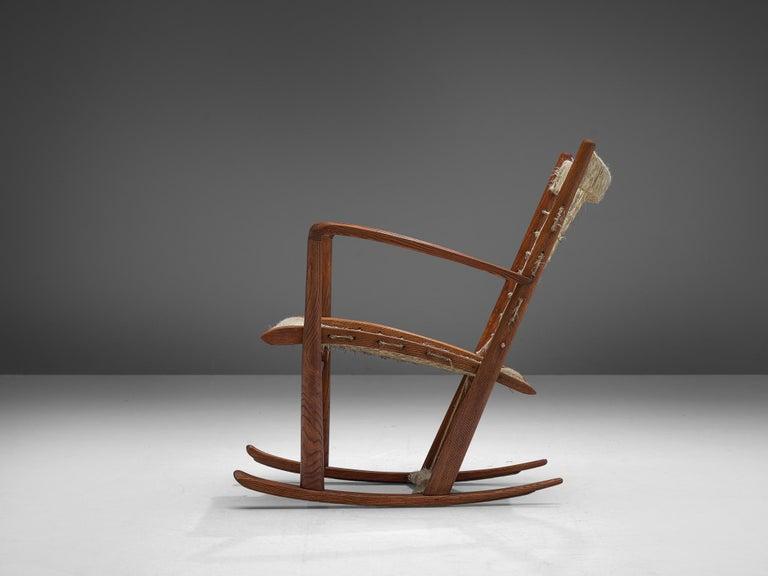 Mid-Century Modern Italian Rocking Chair in Rope and Oak by Guglielmo Pecorini For Sale