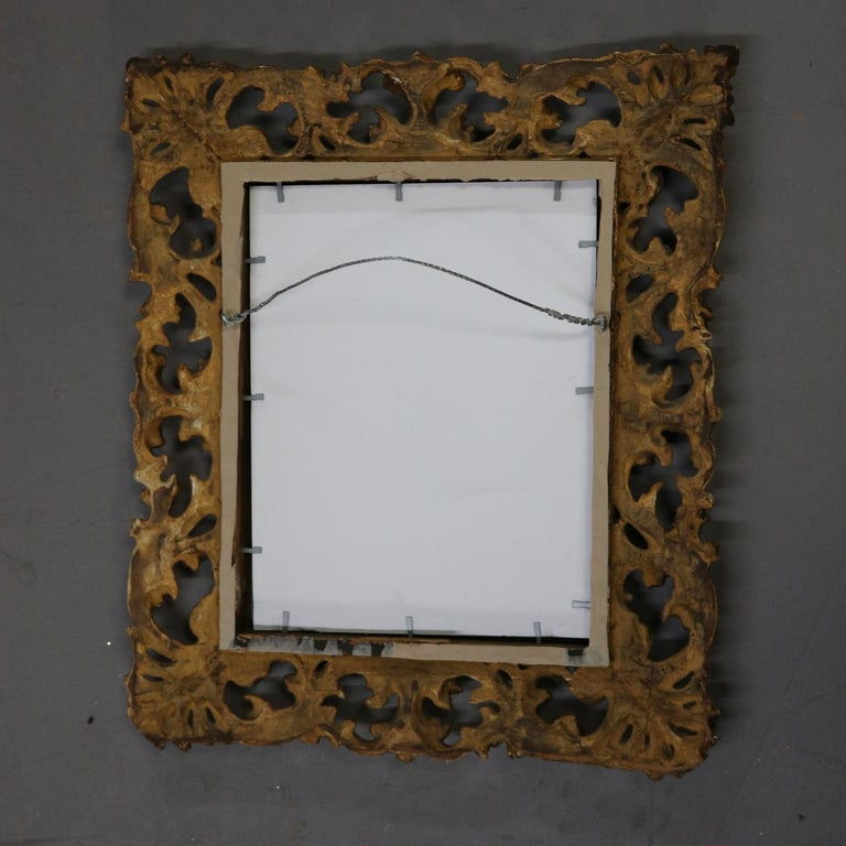 Carved Italian Rococo Style Reticulated Foliate Giltwood Wall Mirror, 20th Century For Sale