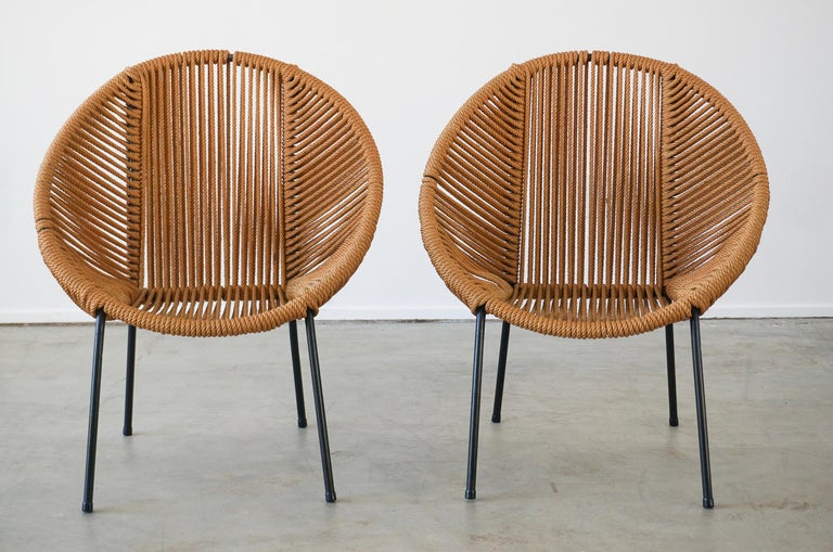Pair of Italian rope chairs with circle hoop iron frame and rope.