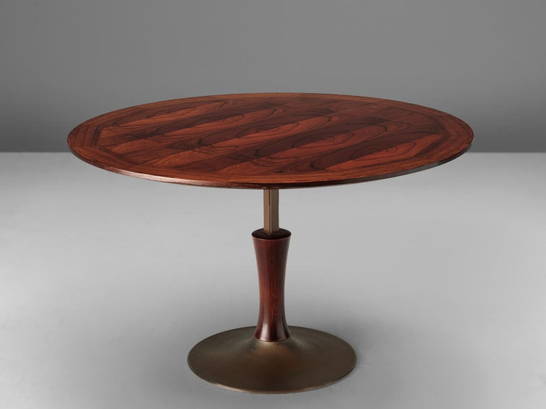 Adjustable table, rosewood and metal, Italy, 1960s  An adjustable round dining table that can be converted to a height of 20.7in/52cm, which makes it suitable as a coffee table as well. The circular table top is made with bookmatched rosewood