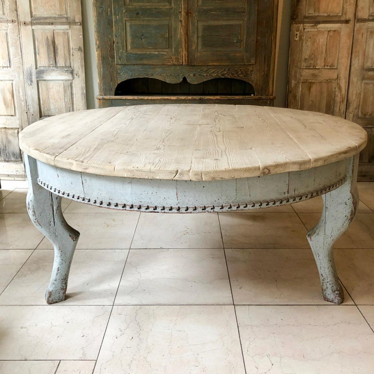 Huge Italian round tree-legged dining table created with old elements in the 19th century style. The tale base painted in pale blue with antique bleached pine top. Here are few examples, surprising pieces and objects, authentic, decorative and