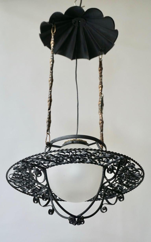 Italian 1950s round painted iron ceiling light with one center light. Diameter 43 cm. Height 77 cm. Diameter glass 18 cm.