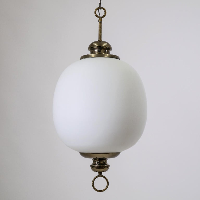 Elegant Italian satin glass pendant from the 1950s with brass and lacquered aluminum hardware. The large blown glass diffuser has a clear inner and opaque outer layer each with a satin finish for a very soft and even light. One brass and ceramic E27