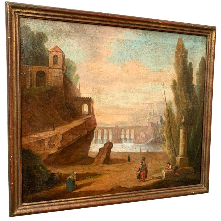 A 18th century oil painting on canvas representing an Italian aquedotto and ruins around Rome. Painting is illustrating working women and children playing in a romantic landscape by a lake.