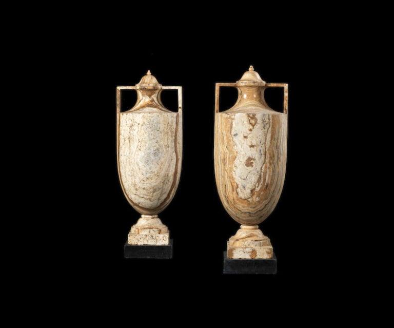 Italian School Figurative Sculpture - A pair of Alabastro Fiorentino classical vases and covers