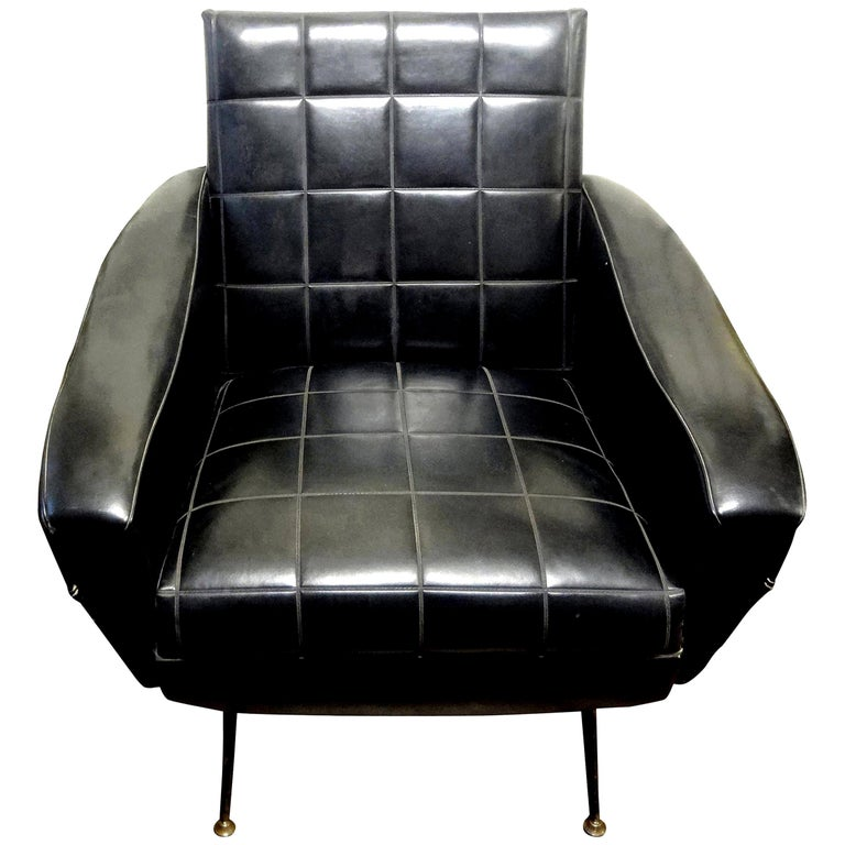 Great sculptural Italian lounge chair after Minotti, Marco Zanuso, Gigi Radice or Gio Ponti. This beautiful Italian lounge chair, club chair or side chair is upholstered in black faux leather with a tufted seat, tufted back and splayed legs.