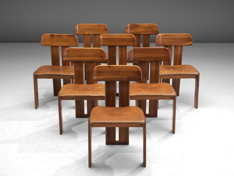 Sapporo for Mobil Girgi, set of 8 dining chairs, Italian walnut and cognac leather, Italy, 1970s.  Set of eight sculptural chairs that feature wonderful backrests, consisting of two vertical slats distanced from each other. At the bottom and top