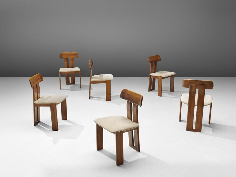 Sapporo for Girgi Mobil, set of 6 dining chairs, Italian walnut and off-white fabric, Italy, 1970s.  Set of sculptural chairs that feature wonderful backrests, consisting of two vertical slats distanced from each other. At the bottom and top these