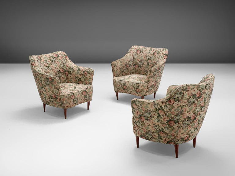 In the style of Gio Ponti, set of three lounge chairs, wood and floral fabric, Italy, 1940s.