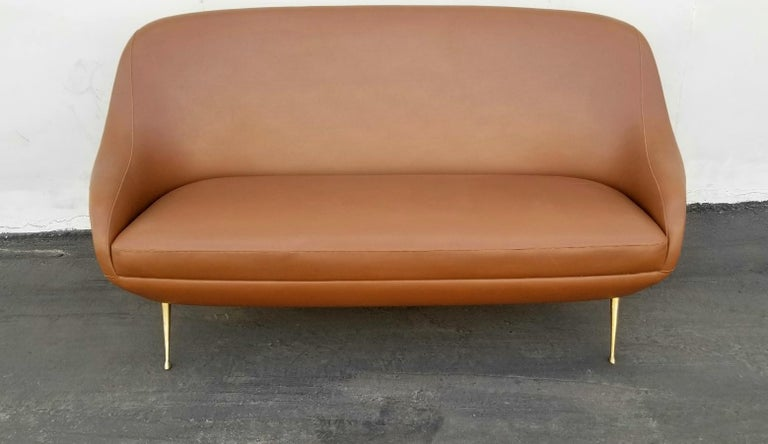 Italian midcentury settee original faux leather upholstery and original midcentury condition.
