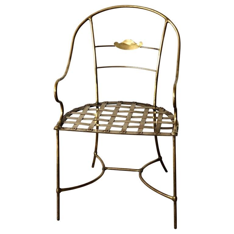 Italian Shiny Brass Art Piece Decorative Armchair with Basket Weave Design Seat For Sale