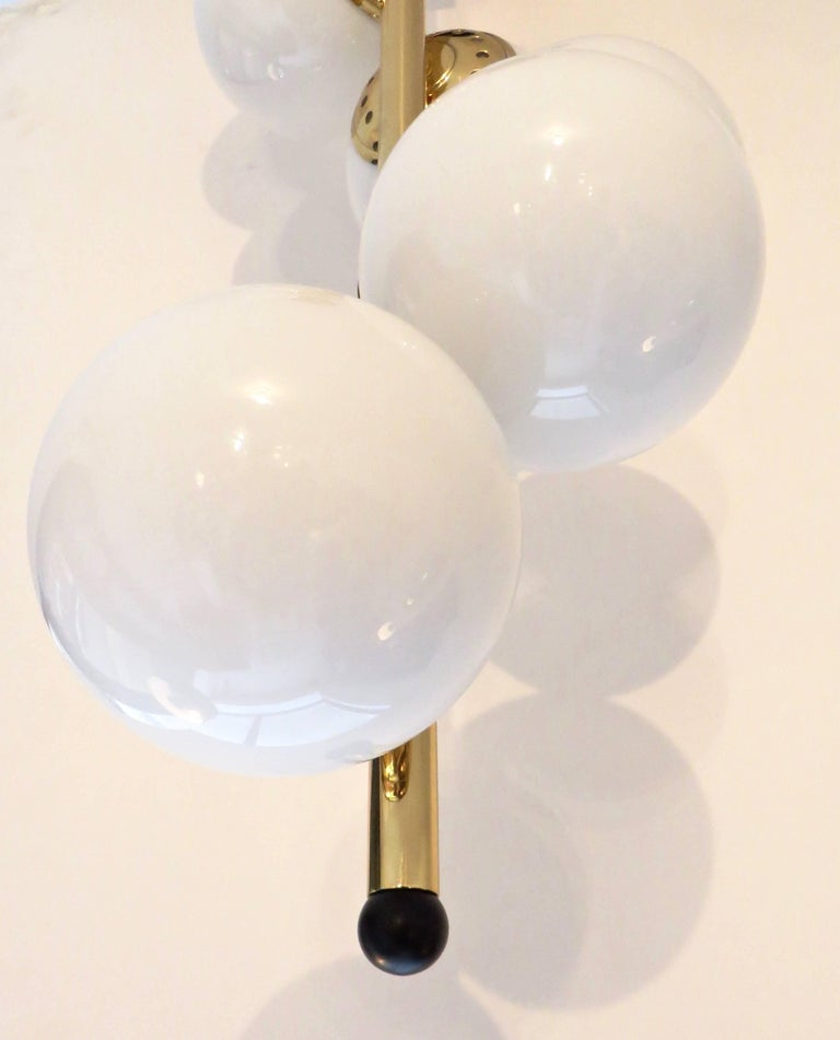 Italian Six-Light Brass and Glass Chandelier with Opaque White Globes, Stilnovo For Sale 2