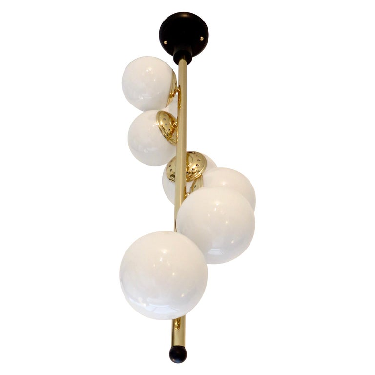 Italian Six-Light Brass and Glass Chandelier with Opaque White Globes, Stilnovo For Sale