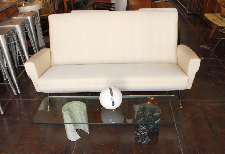 1950s Italian three setter sofa. Metal and brass legs. Sofa just reupholstered in Pana Cotta material.