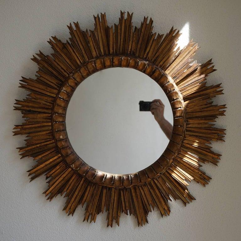 Italian giltwood wall mirror with convex inset mirror. Diameter 73 cm.