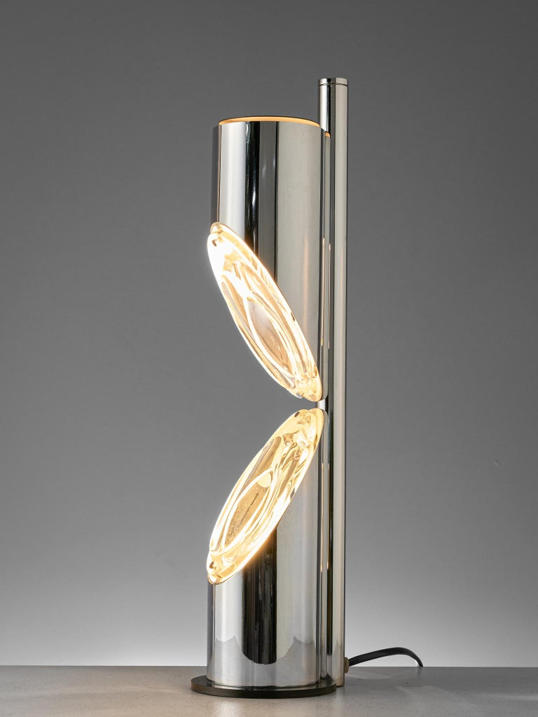 Table lamp, chromed metal, glass, Italy, 1970s  Large chromed metal table lamp manufactured by Luci Illumiazione Cinisello Milano. A futuristic space age design with two metal tubes with each one diagonal side that hold a light source. The light