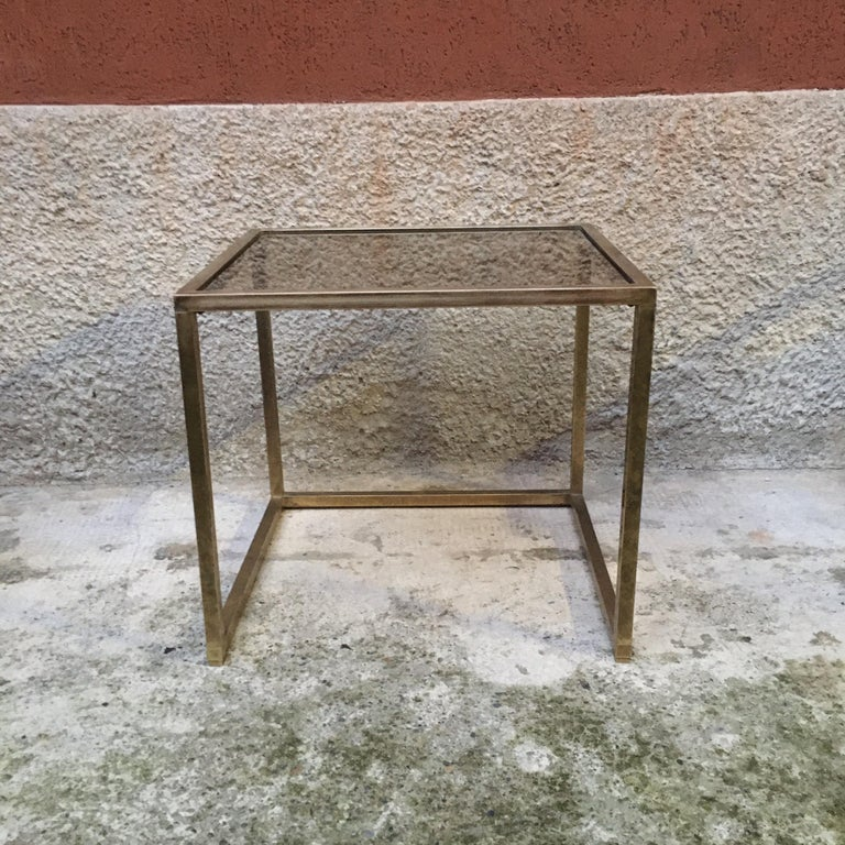 Italian square brass and smoked glass coffee table, 1960s. Square coffee table with brass structure and smoked glass top. Fair conditions.