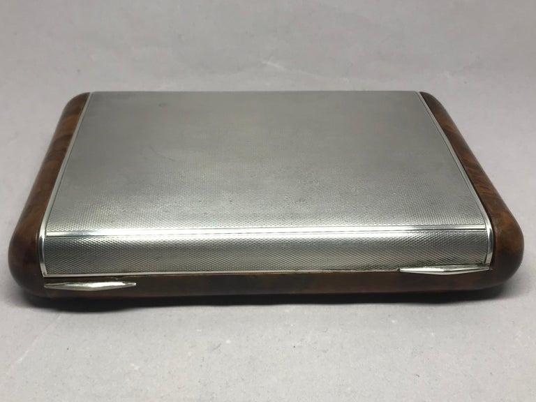 """Italian sterling silver and burl wood box. Midcentury Italian silver hallmark burl wood hinged lidded box for cigarettes or vide-poche. Italy, circa 1940.  Dimensions: 8"""" L x 5"""" D x 1.75"""" H."""