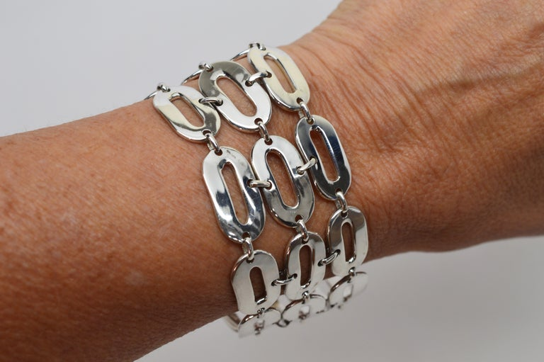Made in Italy and signed by maker, this substantial piece presents a bold, on-trend look.  Sizable oblong links create a  1-1/2 inch wide chain bracelet of quality polished sterling silver. The bracelet length is 7-1/2 inches and finished with
