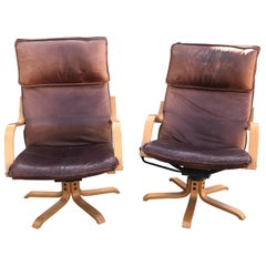 Italian Swiss Tall Lounge Chairs Aged Leather Blonde Wood Star Base 1960s Modern