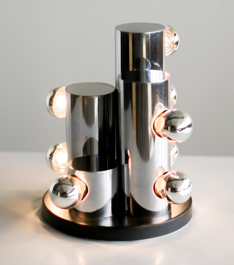 Spectacular Italian Mid-Century Modern table lamp with eight chrome light bulbs.