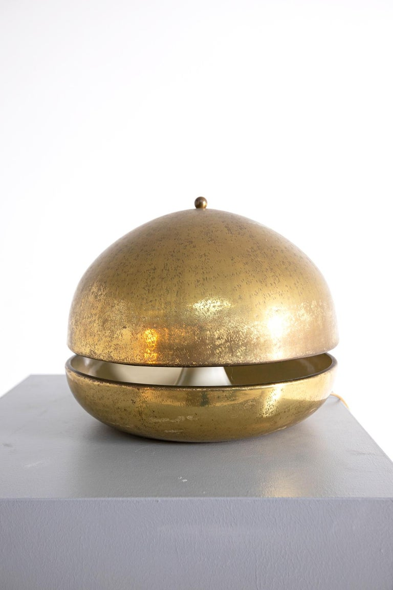 Beautiful 1960's Italian made table lamp. The Italian lamp was made with gilded brass and, as you can see from the photos, has a distinctive semi-oval shape. The Italian lamp is in first patina, and is in its original vintage condition. The wiring