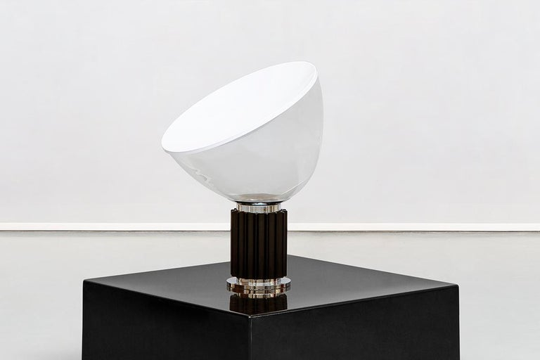 Italian Taccia lamp by Achille & Pier Giacomo Castiglioni for Flos, 1962 Table lamp providing indirect and reflected light. Reflector in painted aluminium, gloss white on the outside and matte white on the inside. Directionable diffuser in