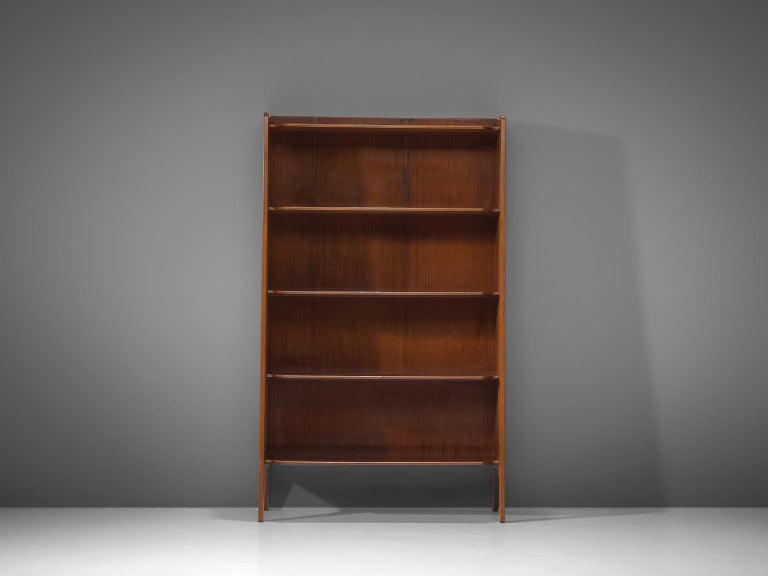 Italian teak bookcase, 1960s  This sophisticated and elegant bookcase designed in Italy comes in a great size. With its beautifully shaped shelves, it's an easy yet very stylish way to store your books or to display your favourite collectables.