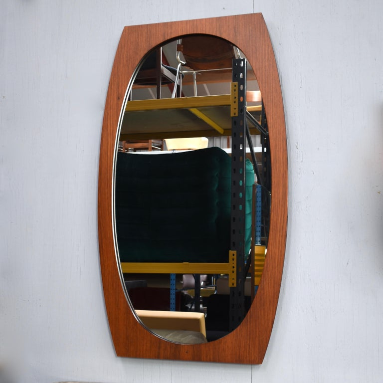 Italian Teak mirror, 1950s. The wood frame is made out off one piece of solid Teak.  Designer: Unknown  Manufacturer: Unknown  Country: Italy  Model: Mirror  Design period: circa 1950  Date of manufacturing: circa 1950  Size cm WxDxH: