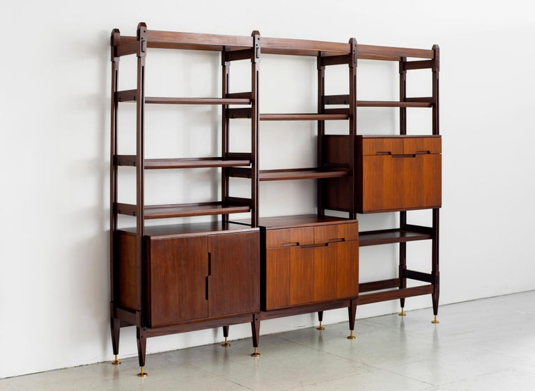 1960s Italian teak free floating wall unit / bookcase with multiple shelves and compartments for storage. 